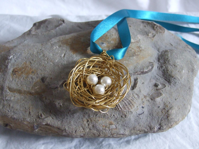 Brass nest pendant a cute birds nest pendant made from wire with brass nest pendant a cute birds nest pendant made from wire with three white pearl bead eggs aloadofball Choice Image